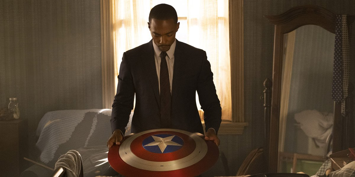 Sam Wilson/Falcon (Anthony Mackie) looks at Captain America's shield in The Falcon And The Winter Soldier