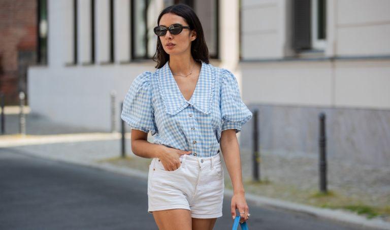 Alyssa Cordes is seen wearing white shorts Levis, blue gingham checkered top Envii, Adidas sneaker, Prada bag in blue, sunglasses Mango on June 14, 2021 in Berlin, Germany.