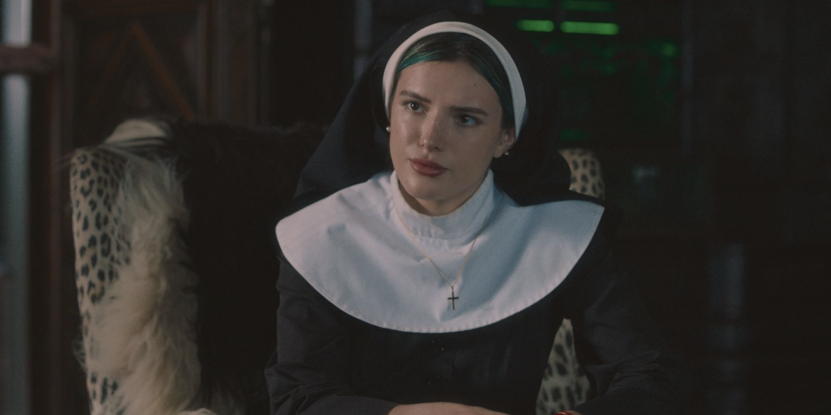 Bella Thorne dressed as a nun in Habit, looking quizzically