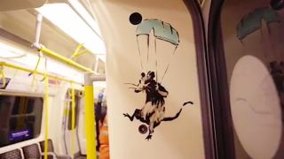Coronavirus-themed art appears (briefly) on London Underground.