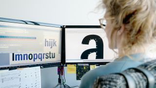 A typographer working on a piece of digital typography