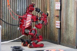 The CHIMP robot participates in DARPA's robotics challenge.