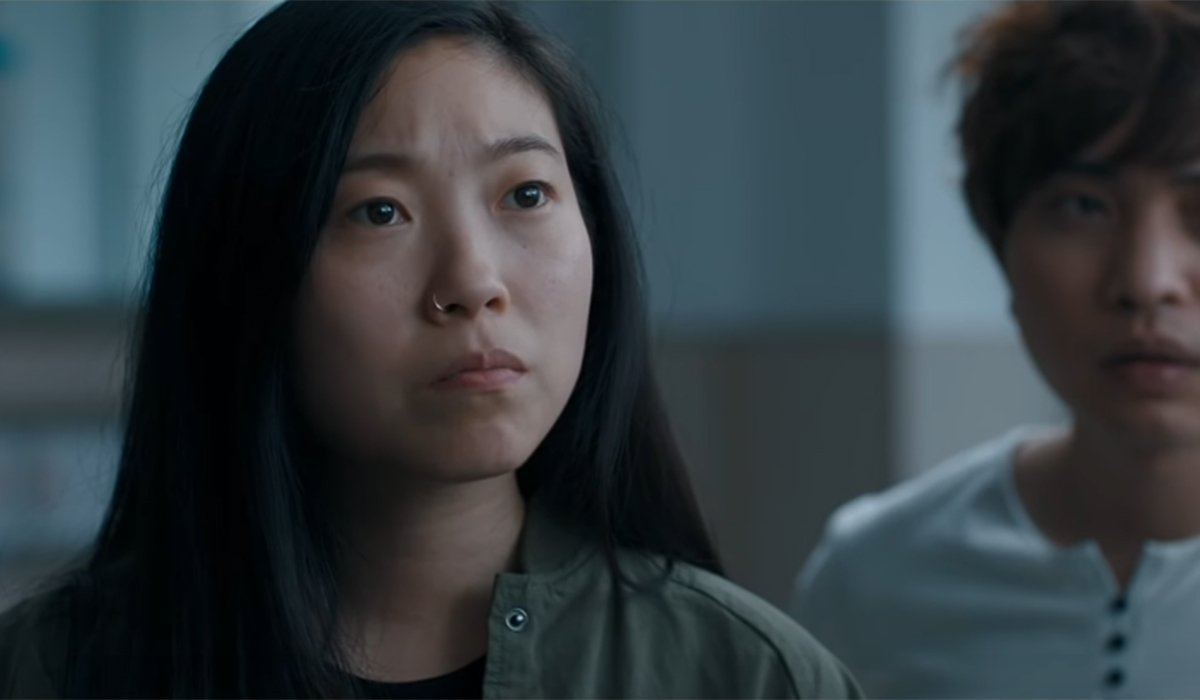 Awkwafina looking troubled in The Farewell