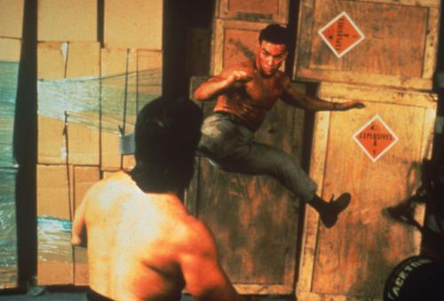 Double Impact - Jean Claude Van Damme in high-kicking action in his 1991 action film.