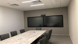 Data Projections prepared its client's office space for a virtual trial, configuring a state-of-the-art conference facility with a sophisticated web of interconnected monitors, interactive displays, control panels, an integrated sound system, and streaming capabilities.