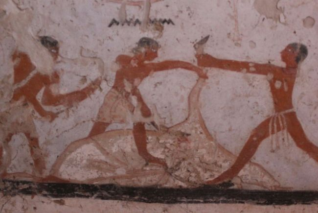In this painting from Hetpet's tomb, three men appear to be in the process of slaughtering a cow.