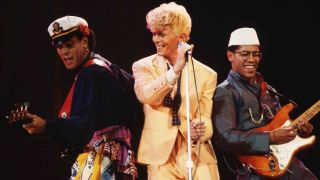 Bowie performing with Carlos Alomar (right) in the 80s