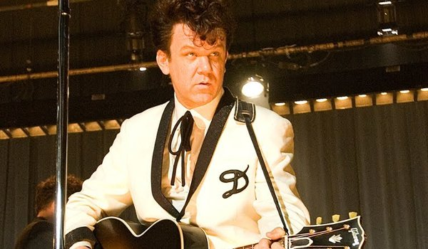 Walk Hard: The Dewey Cox Story John C. Reilly playing guitar on stage