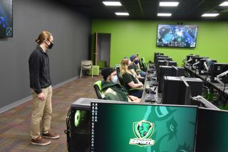 Point Park University head coach Chris Gaul oversees student competition at the new esports training facility.