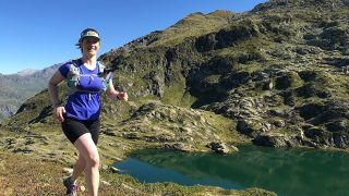 Claire Maxted running in the mountains