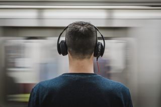 A man wearing headphones on a platform