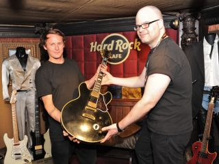 UK singer songwriter Ben Howard donating one of his old guitars