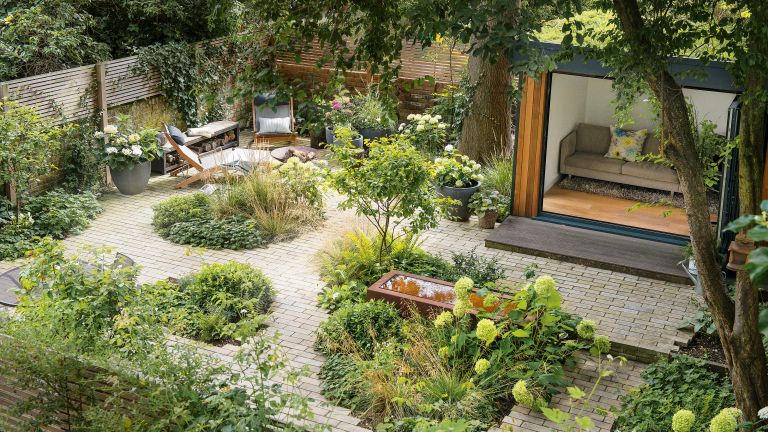 landscaping ideas with paving, planting and garden building