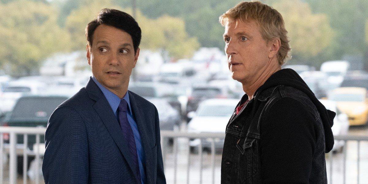 Daniel LaRusso (Ralph Macchio) and Johnny Lawrence (William Zabka) look on in Cobra Kai (2021)