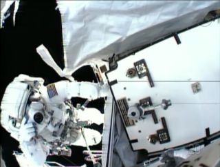 NASA astronaut Tom Marshburn snaps a photo of crewmate Chris Cassidy during a May 11, 2013 spacewalk in this view from Cassidy's helmet camera.