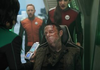 "The Orville crew rescues Orrin Channing (Mackenzie Astin), an escaping prisoner of war of the Krill who turns out to be an old friend of Lt. Malloy (Scott Grimes) in ""The Orville"" episode ""Blood of Patriots."""