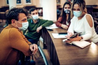 People wearing face masks indoors