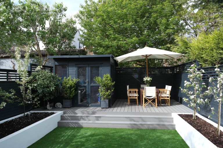 Parasol deal: Decking ideas with raised grey decked area from Ecodek