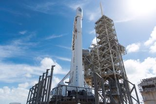 A SpaceX Falcon 9 rocket carrying the classified NROL-76 spy satellite for the U.S. National Reconnaissance Office stands atop Launch Pad 39-A at NASA's Kennedy Space Center in Cape Canaveral, Florida. A first stage sensor issue has delayed the launch to