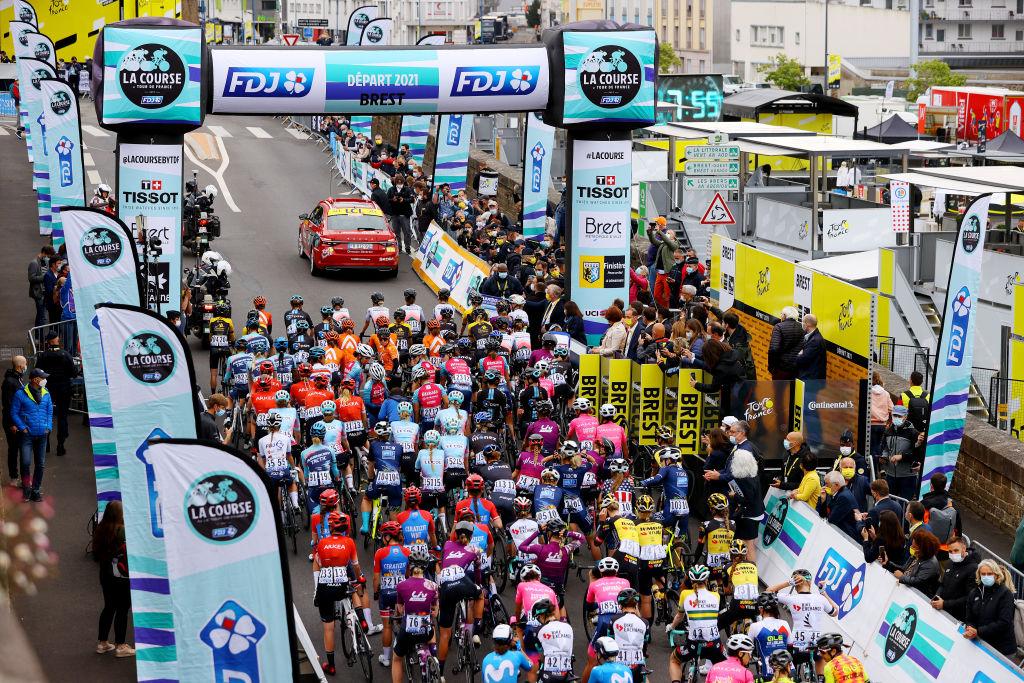 LANDERNEAU FRANCE JUNE 26 The peloton at start in Brest during the 8th La Course By Le Tour De France 2021 a 1077km race from Brest to Landerneau Cte De La Fosse Aux Loups 176m Landscape LaCourse LeTour TDF2021 UCIWWT on June 26 2021 in Landerneau France Photo by Tim de WaeleGetty Images
