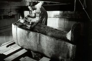 Man cleaning sarcophagus