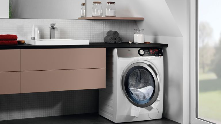 Best washer dryer: AEG lifestyle image of washer dryer