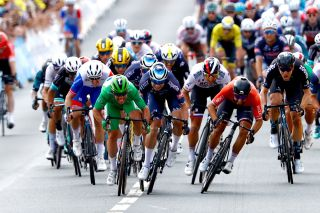 Nacer Bouhanni (right) sprinting to the line in Châteauroux against Mark Cavendish and Jasper Philipsen