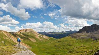 Hiker enjoys grand view of alpine tundra in Colorado