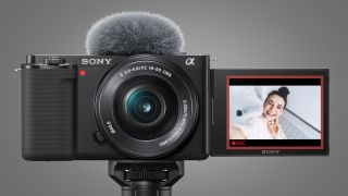 The front of the Sony ZV-E10 vlogging camera with its screen flipped out to face forwards
