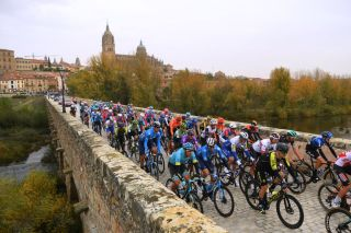 CIUDADRODRIGO SPAIN NOVEMBER 06 Start Omar Fraile Matarranz of Spain and Astana Pro Team Carlos Verona Quintanilla of Spain and Movistar Team Alexander Edmondson of Australia and Team Mitchelton Scott Salamanca City Peloton Bridge Landscape during the 75th Tour of Spain 2020 Stage 16 a 162km stage from Salamanca to Ciudad Rodrigo lavuelta LaVuelta20 La Vuelta on November 06 2020 in Ciudad Rodrigo Spain Photo by David RamosGetty Images