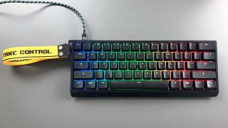 Wooting 60HE keyboard on a desk with a cable attached