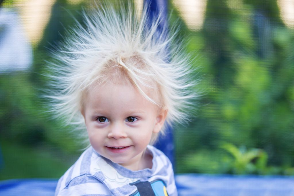 A little boy with hair standing on end from static electricity