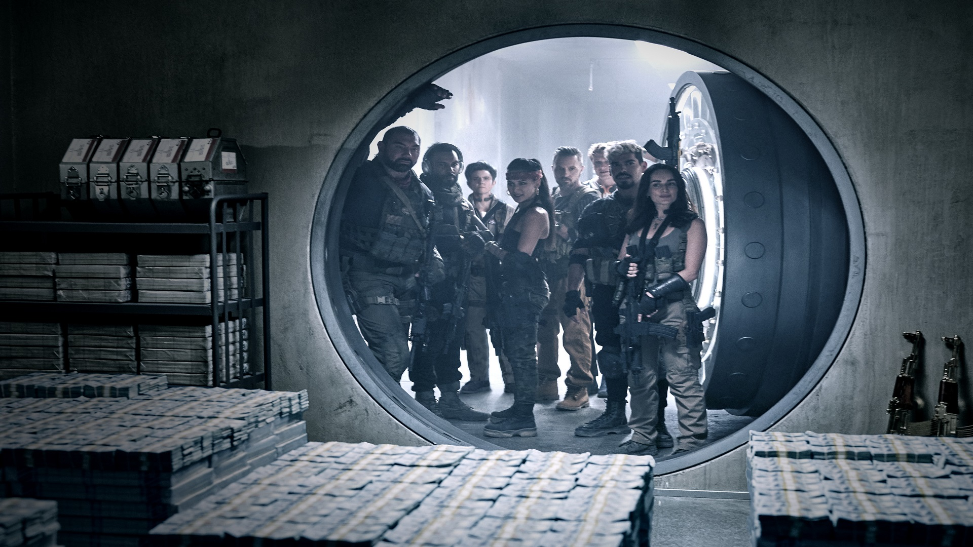 Army of the Dead's cast look at a vault of money in Zack Snyder's zombie heist movie