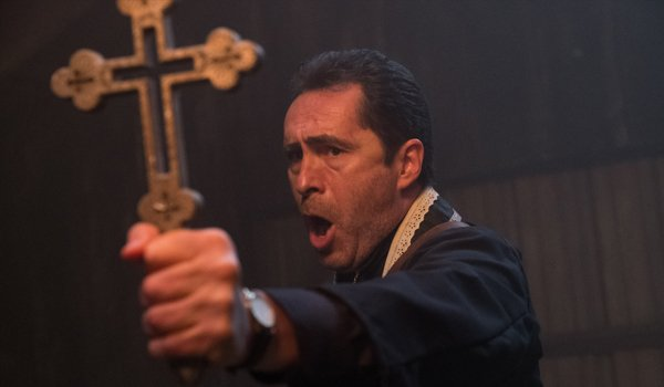 The Nun Demian Bichir Father Burke holding a cross and shouting
