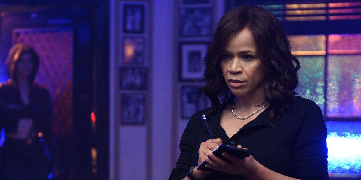 Renee Montoya (Rosie Perez) observes a crime scene in Birds of Prey (2020)