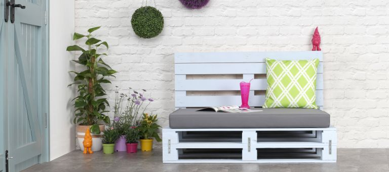 pallets made into an outdoor sofa and painted bllue