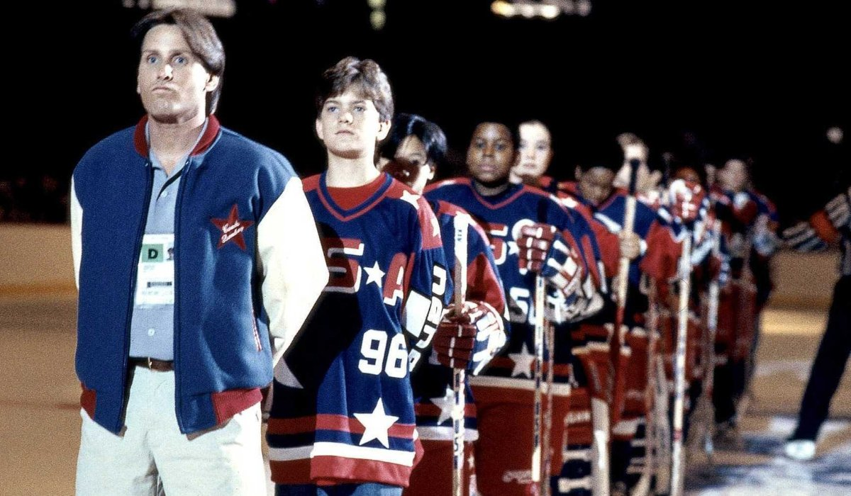 D2: The Mighty Ducks Emilio Estevez stands in line with his young Olympic team