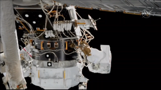 The Spacewalker Hague and Morgan install cables for the new docking port of the ISS.