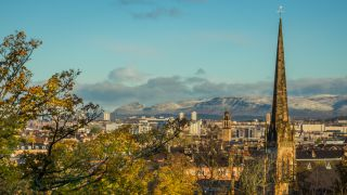 The city of Glasgow with mountains in the background