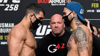 Rodolfo Vieira and Anthony Hernandez facing off at the UFC 258 weigh in.