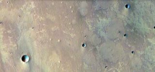 Conical hills on Mars may be evidence of mud volcanoes, scientists say.