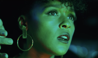Janelle Monáe looks on in the club in Antebellum