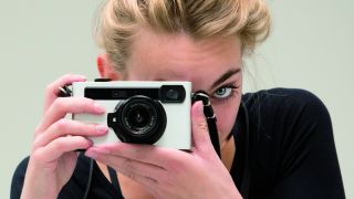 Woman holding Pixii camera