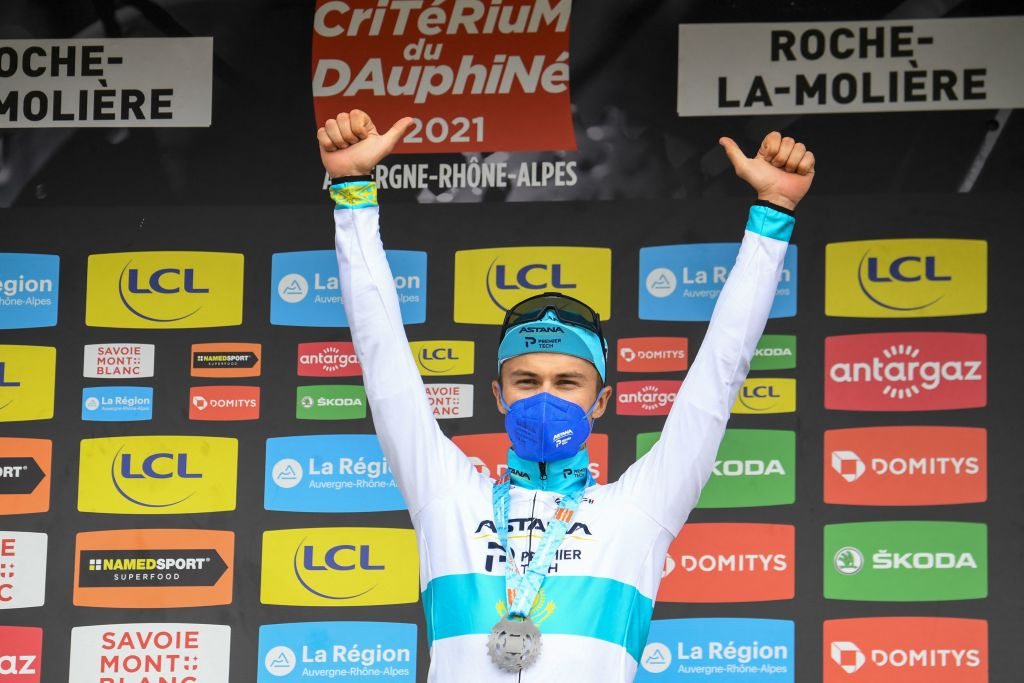 Stage winner Team Astanas Alexey Lutsenko of Kazakhstan celebrates on the podium after winning the fourth stage of the 73rd edition of the Criterium du Dauphine cycling race a 16km time trial between Firmigny and RochelaMoliere on June 2 2021 Photo by Alain JOCARD AFP Photo by ALAIN JOCARDAFP via Getty Images