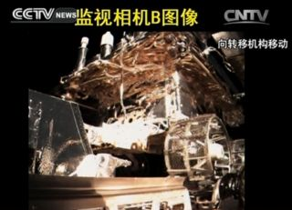 A camera on China's Chang'e lunar lander shows the Yutu rover in its carrier just before deployment to the lunar surface on Dec. 14, 2013.