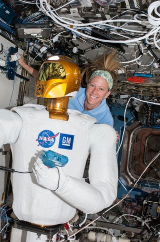 Astronaut Nyberg and Robonaut 2