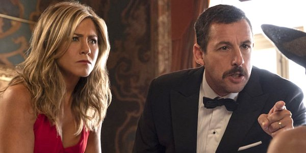 Netflix Murder Mystery Jennifer Aniston Adam Sandler points in tuxedo