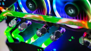 A close up shot of a graphics card and water block in a gaming PC