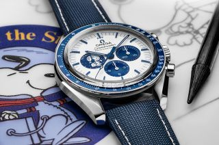 """The Omega Speedmaster """"Silver Snoopy Award"""" 50th Anniversary chronograph celebrates the role the Swiss watchmaker played in saving Apollo 13 and NASA's comic strip beagle-adorned lapel pin presentation in return."""