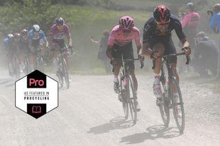 Filippo Ganna leads Egan Bernal on the sterrato of stage 11